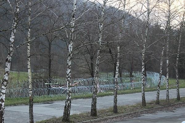 Barbed wire rolls along the Bregana river in in Obrežje.